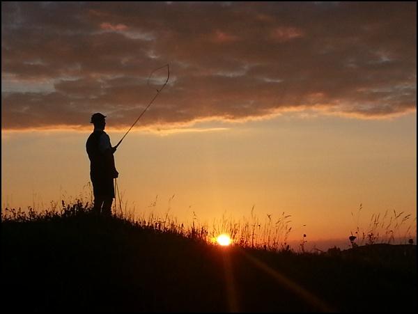Goaßlschnalzer im Sonnenuntergang