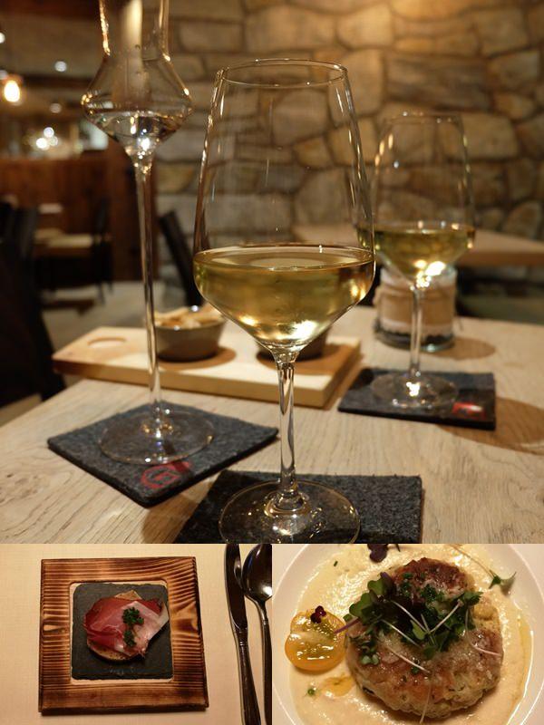 Südtiroler Köstlichkeiten im Gassenhof: Wein, Erdbeerbrand, Speck, Brot, Graukäseknödl